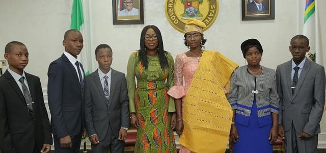 Wife of the Governor of Lagos State, Mrs Bolanle Ambode (middle); One-Day Governor of Lagos State, Miss Zuffon Bukola (2nd right); One-Day Deputy Governor, Miss Rosemary Ogidan (r); Speaker LSHA, Master Philip Daniel (2nd left); HC Education, Master Ayomide Durojaiye (2ndleft); SSG, Master Tovishede Abayomi (r); and Master Atabo Ufedejo, during the 2017 One-Day Governor and her Cabinet members paid a courtesy visit to the wife of the Governor, at Lagos House, Ikeja.